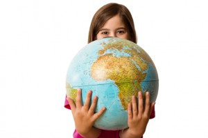 Cute-pupil-smiling-holding-globe-000048106420_Small